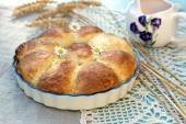 Sweet stuffed buns brioches with flowers — Stock Photo