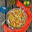 Постер, плакат: Potatoes skillet with pumpkin and herbs