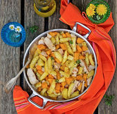 Potatoes skillet with pumpkin and herbs — Stock Photo
