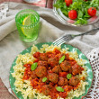 Pasta with mini meatballs with tomato sauce — Stock Photo #58898503