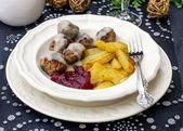 Swedish meatballs coated in creamy gravy — Stock Photo