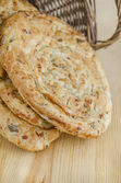 Puff pastry with cheese, parsley, dill and spring onions — Stock Photo