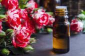 Essential rose oil — Stock Photo