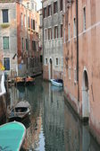 Traditional Venice boat parked in a narrow canal — Stock Photo