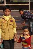 Child in Delhi, India, an image of poverty in modern age. — Stock Photo
