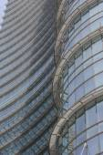 Architectural detail of the glass facade on the Unicredit tower building in Milan — Stock Photo