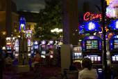 People playing at Slot Machines at night — Stock fotografie