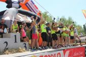 Team of a running competition on the stage — Stock Photo