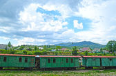 Old railroad wagons on a background of mountains  — Stock Photo