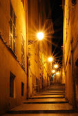 Night alley with steps of light rays in Nice, France — Stockfoto