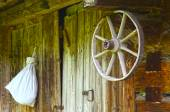 Rural landscape in vintage style with old wooden wheel close up — Stok fotoğraf