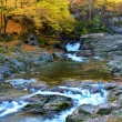 Picturesque autumn landscape of waterfalls on the River (relaxat — Stock Photo #57592941