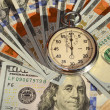 Stopwatch and dollars (time is money, capital, savings, profit - — Stock Photo #60535701
