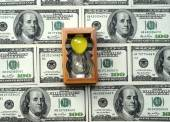 Sand-clock and dollars (time is money, capital, savings, profit  — Stock Photo