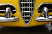 Interesting design of old yellow car with original grille and ch — Stock Photo
