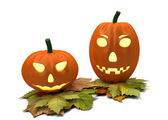 Two halloween pumpkins isolated on white — Stock Photo
