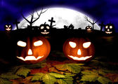 Spooky Halloween background with pumpkins in a cemetery — Stock Photo
