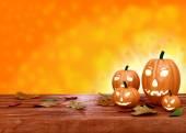 Halloween pumpkin lanterns on orange background — Stockfoto
