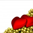 Two red hearts and glossy golden speres on background — Stockfoto #53010403
