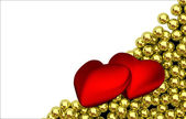 Two red hearts and glossy golden speres on background — Photo