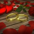 Two golden wedding rings and red rose with petals — Stock Photo #54715531