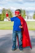 Superhero standing with arm raised — Stock Photo