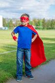 Superhero standing and looking towards — Stock Photo