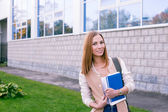 Student standing on building background — Stock Photo