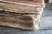 Old books on a wooden background — Stock Photo