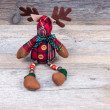 Christmas reindeer toy on wooden background — Stock Photo #63480247