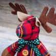 Christmas reindeer toy on wooden background — Stock Photo #63484203
