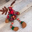 Christmas reindeer toy on wooden background — Stock Photo #63484205
