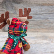 Christmas reindeer toy on wooden background — Stock Photo #63484351
