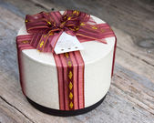 Gift box on a wooden background — Stock Photo