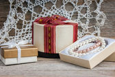 Gift boxes on a wooden background — Stock Photo