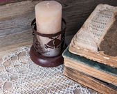 Old book and a Christmas candle holder — Stock Photo