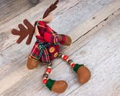 Christmas reindeer toy on wooden background — Foto de Stock