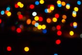 Red and orange holiday bokeh. Abstract Christmas background — Stock Photo