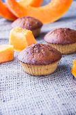 Pumpkin muffins on a burlap background — Stock fotografie