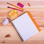 School supplies on wooden background — Stock Photo