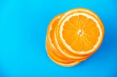 Stack of sliced oranges on a blue background — Стоковое фото