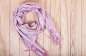 Pink scarf on a wooden background — Zdjęcie stockowe