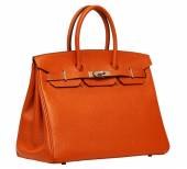 Women's orange leather handbag — Photo