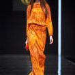 Постер, плакат: A model walks on the VALENTIN YUDASHKIN catwalk
