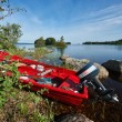 Red boat powered by the lake — Stock Photo #68203715