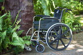 Wheelchair in nature — Stock Photo