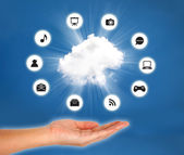 Cloud on hand against blue sky. cloud computing concept. — Stock Photo