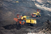 Big mining truck unload coal — Stock Photo