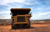 Big yellow mining truck at work site — Stock Photo