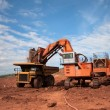 Truck is being loaded with ore at a mine site — Stock Photo #74444429